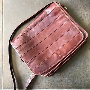 Vintage leather messenger bag by Importa Ltd.